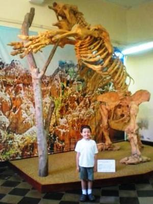 My cousin Kricket and a giant sloth in Tarija, Bolivia