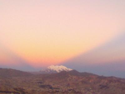 Sunrays reflecting off the Illimani peaks