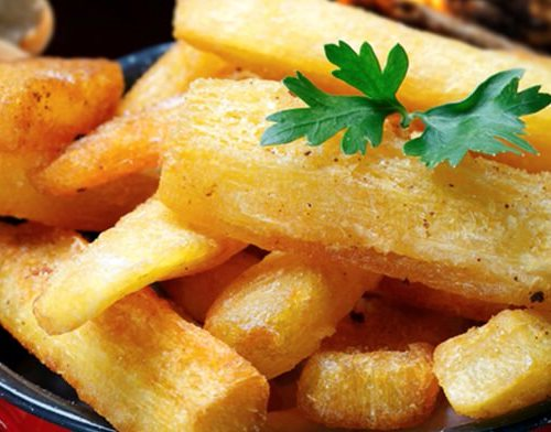 Serve the yuca frita hot and salty!