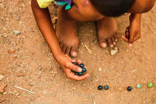 Matacuca, a popular marbles game in Bolivia