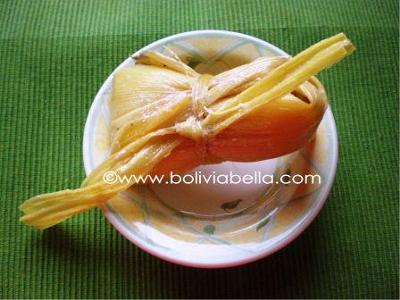 Huminta. Ground white corn and cheese boiled in a tied husk.